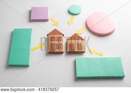 Colorful Rectangles And Circles With Pointing Arrows At Two Houses