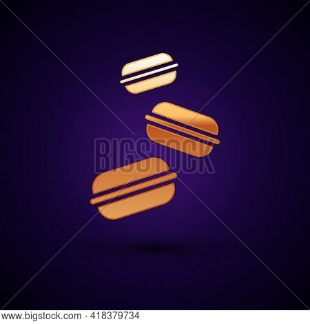 Gold Macaron Cookie Icon Isolated On Black Background. Macaroon Sweet Bakery. Vector