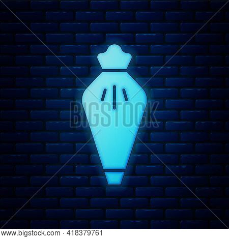 Glowing Neon Pastry Bag For Decorate Cakes With Cream Icon Isolated On Brick Wall Background. Kitche