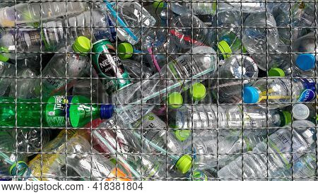 3,mar,2018,lopburi Thailand,pile Of Empty Water Plastic Bottle In Mesh Fence Recycle Bin. Plastic Bo