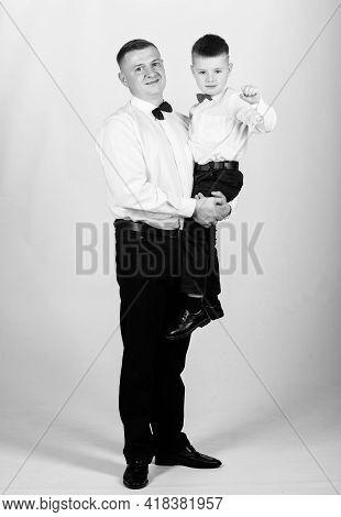 Gentleman Upbringing. Father Carry Hug Son Formal Clothes Outfit. Grow Up Gentleman. Gentleman Upbri