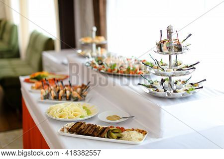 Yummy Banquet Meals On Table With White Tablecloth.