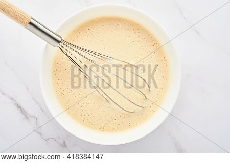 Preparation Of Dough For Home Pancakes For Breakfast Or For Maslenitsa. Ingredients On The Table Whe