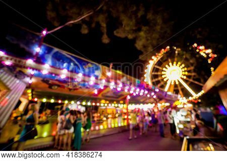Children\'s Carousel At An Amusement Park In The Evening And Night Illumination. Amusement Park At N