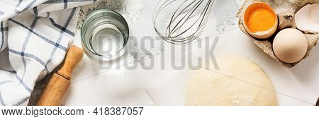 Dough And Ingredients For The Preparation Of Pasta, Dough, Eggs, Flour, Water And Salt On A Light Ru