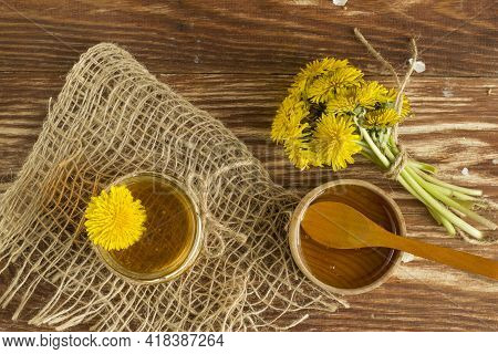 Homemade Delicious Flower Dandelion Honey On A Light Wooden Table With Yellow Dandelions. Dandelion