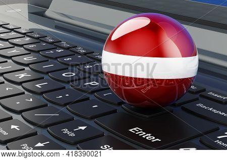 Latvian Flag On Laptop Keyboard. Online Business, E-education, Shopping In Latvia Concept. 3d Render