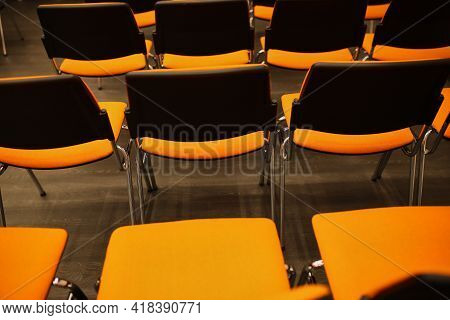 Black And Orange Plastic Conference Chairs. Black And Orange Chairs In The Conference Room. Backgrou