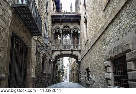 Spain, Barcelona, March, 2021: Pont Del Bisbe And Narrow Street Near Gothic Cathedral Of The Holy Cr