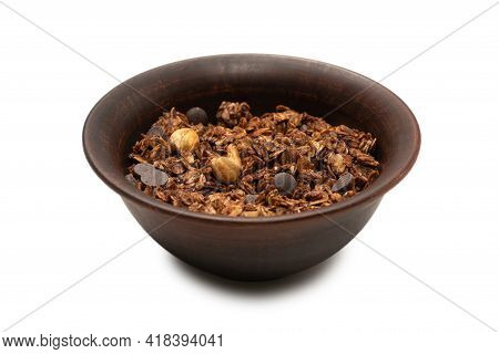 Chocolate Granola Cereal With Nuts In A Bowl Background. Isolated On White Bacckground.