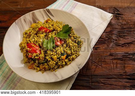 Food For Suhoor In Ramadan Bulgur Post With Vegetables In A Plate On A Wooden Table On A Napkin. Hor