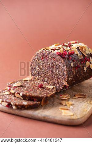 Handmade Chocolate, Cacao Vegan Sweet Dessert On Wooden Background. Healthy Raw Vegetarian Sweets. S