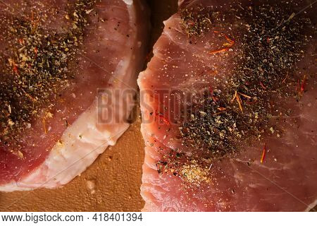 Veal Steak On A Cutting Board. Veal Steak With Spices On A Plastic Cutting Board. Raw Veal Steak Wit