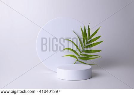 White Podium On The White Background With Tropical Leaf. Podium For Product, Cosmetic Presentation.