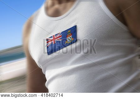 The National Flag Of Cayman Islands On The Athletes Chest