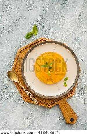 Dessert, Orange Jelly On A Ceramic Plate On A Light Concrete Background. Desserts Without Baking