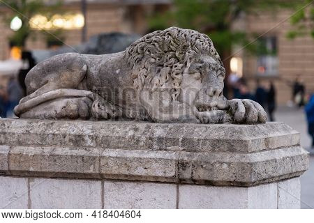 Lion Statue In Krakow. An Old Statue At The Entrance To One Of The Cathedrals In The Square.