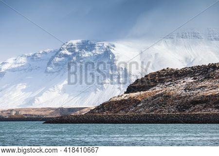 Iceland, Coastal Landscape With Snowy Mountains Under Blue Cloudy Sky. Reykjavik District