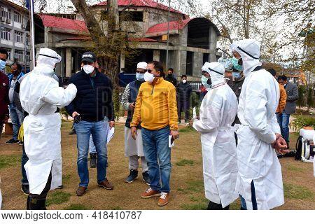 White Dressed Men Sanitizing City In Covid Lockdown.