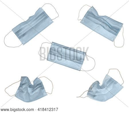 Five Different Blue Face Masks, Each Isolated On White For Your Convenience.