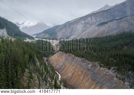 View From Columbia Icefield Skywalk Into A Valley In Canadian Rockies. Cold, Cloudy, Hazy Day In The