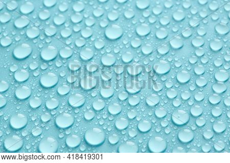 Pure Water Drops Texture Or Clear Background. Turquoise Abstract Background. Fresh Water Droplets.