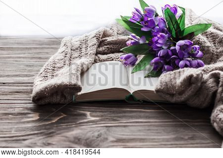 Cozy Morning. Opened Book And A Bouquet Of Flowers On A Wooden Background With Copy Space. Cozy Home