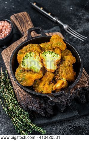 Roasted Crumbed Broccoli In A Pan. Black Background. Top View