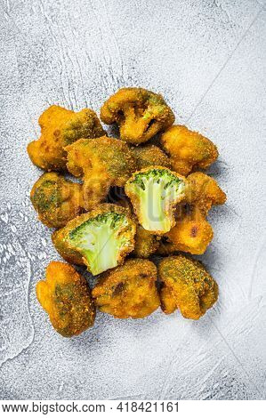 Fried Crumbed Broccoli On Kitchen Table. White Background. Top View