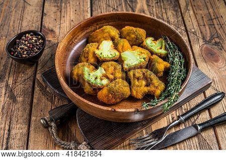Breadcrumb Broccoli In A Wooden Plate With Thyme. Wooden Background. Top View