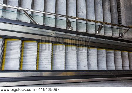 Empty Escalator And Stairs Separated By Glass Railings In Underpass. Modern Transportation, Urban In