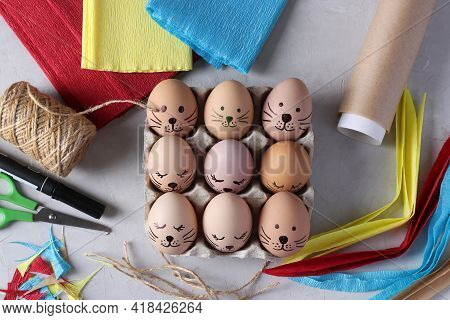 Decorate Eggs For Easter Using Colored Paper And Parchment In The Form Of Rabbits. Using A Marker, D