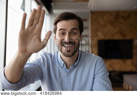 Portrait Of Smiling Man Wave Talking On Video Call