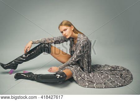 Trendy Outfit. Fashion Week Clothes. Gorgeous Glamour Fashion Woman. Provocative Snake Print.