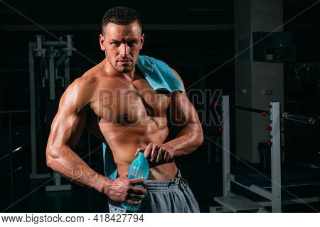 Stay Hydrated Concept. Weightlifter Gym Man Preparing For Training. Muscular Athletic Body. Sport He