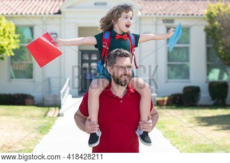 Outdoor School. School Boy Going To School With Father. Dad And Son Having Fun Near School Yard. Con