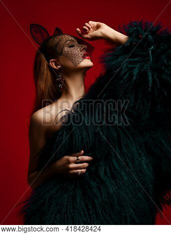 Portrait Of Arrogant Rich Young Red-haired Woman Wearing Luxury Fur Coat Over Naked Body And Veiling