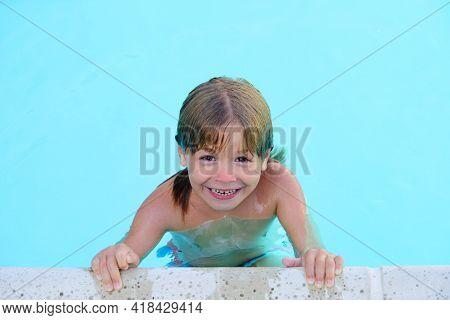 Child In Summer Pool. Summer Vacation Activities On Pool. Having Fun At Aquapark. Kid Swimming In Wa