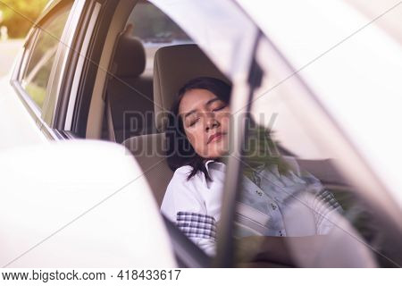 Woman Take A Nap On Car During On The Way,safety And Driving Concept,women Sleeping On Vehicle