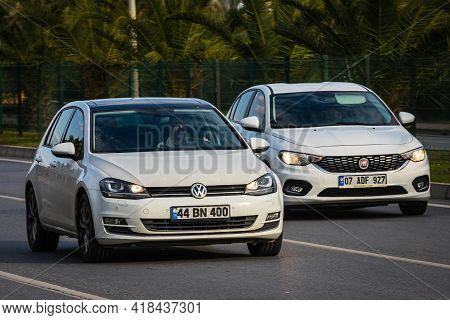 Alanya, Turkey  - April 13  2021:    White Ford Golf And Fiat Albea     Is Driving Fast On The Stree