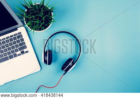 Flat Lay Of Laptop Computer And Plant On Desk In Office, Workplace And Notebook And Potted Tree And