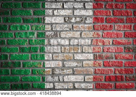 National Flag Of Italy Depicting In Paint Colors On An Old Brick Wall. Flag  Banner On Brick Wall Ba