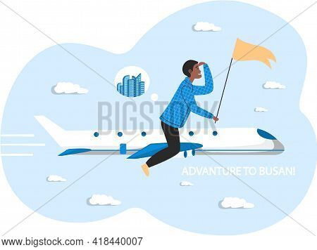 Man Flying To Korean City Busan On White Plane. Person Travels With Yellow Flag In His Hand Riding A