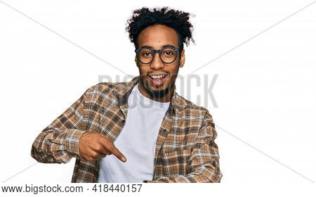 Young african american man with beard wearing casual clothes and glasses in hurry pointing to watch time, impatience, upset and angry for deadline delay