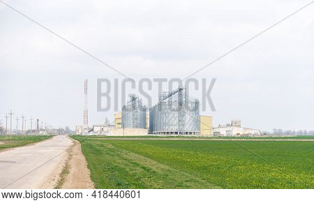 Grain Elevator. Metal Grain Elevator In Agricultural Zone. Agriculture Storage For Harvest. Grain El