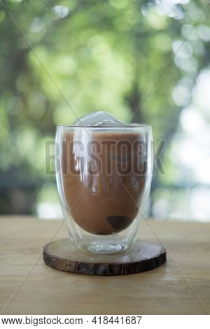 Iced Mocha Coffee Served In The Designed Double-wall Glass At Coffee Cafe. Look Delicious, Concept O