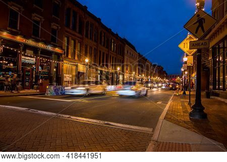 NORWALK, CT, USA - APRIL 24, 2021: Busy weekend evening on Washington Street  with evening lights
