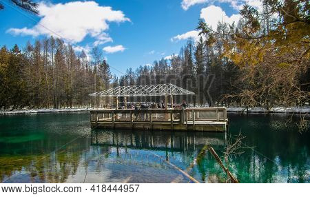 Manistique, Michigan, USA on March 5, 2021: Covered boat tour at  Kitch-iti-kipi, hot springs lake in Michigan upper peninsula