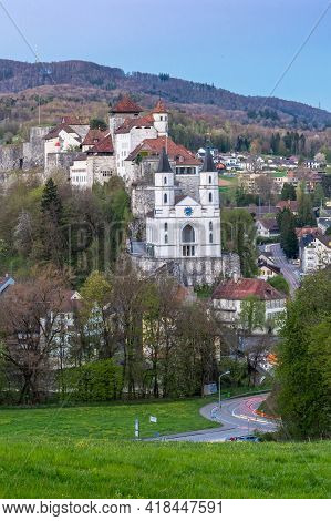 Aarburg, Switzerland - April 23, 2021: The Castle Of Aarburg In Switzerland And A Reformed Church Ar