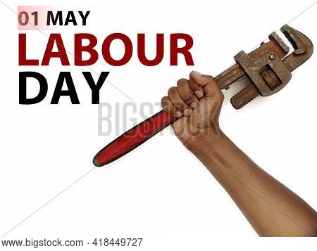 Happy World Labour Day In 1st May Background. Labour Day Simbolism Concept Hand With Pipe Wrench. In